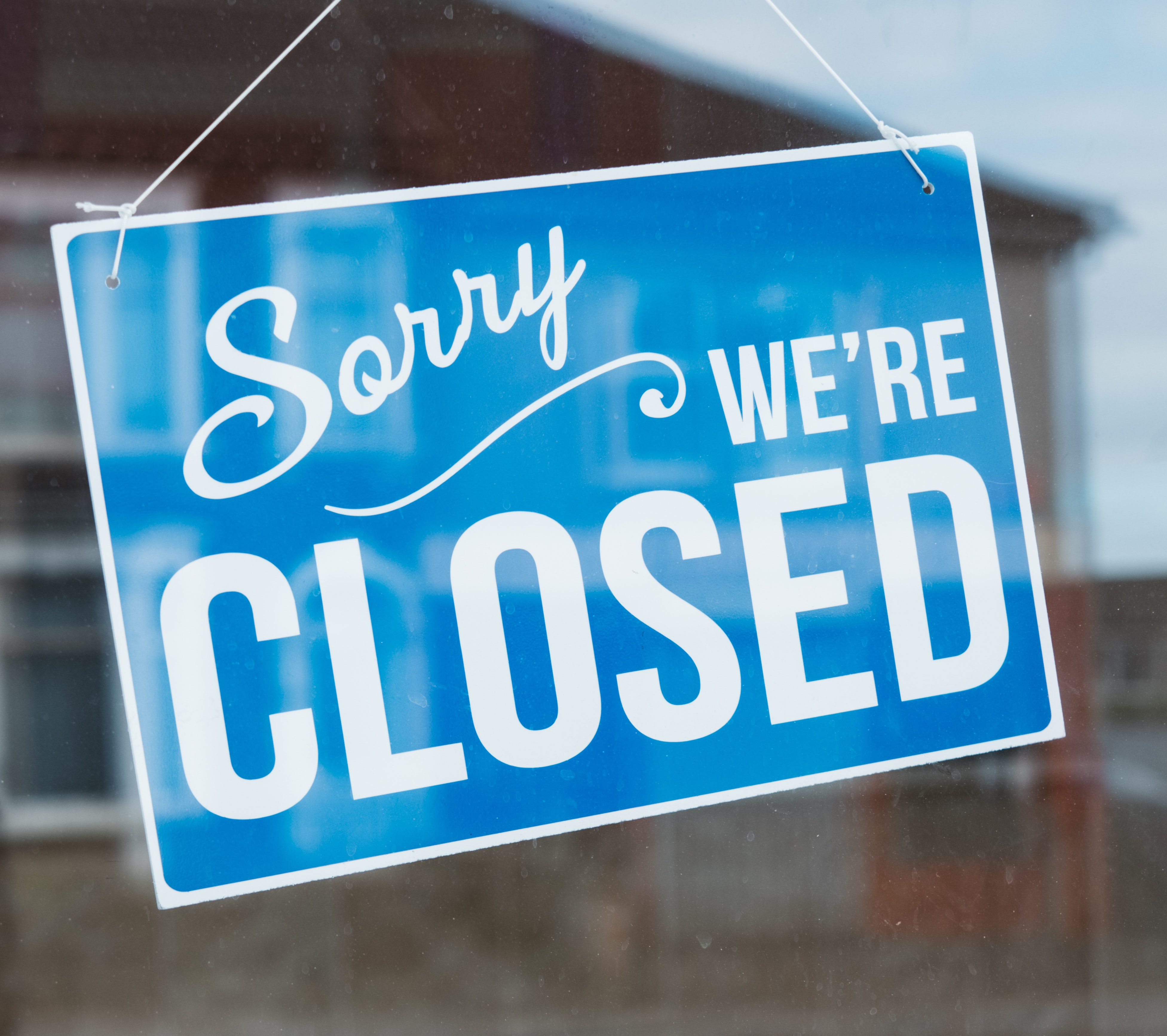 closed-sign-ing-on-a-glass-item-4040717